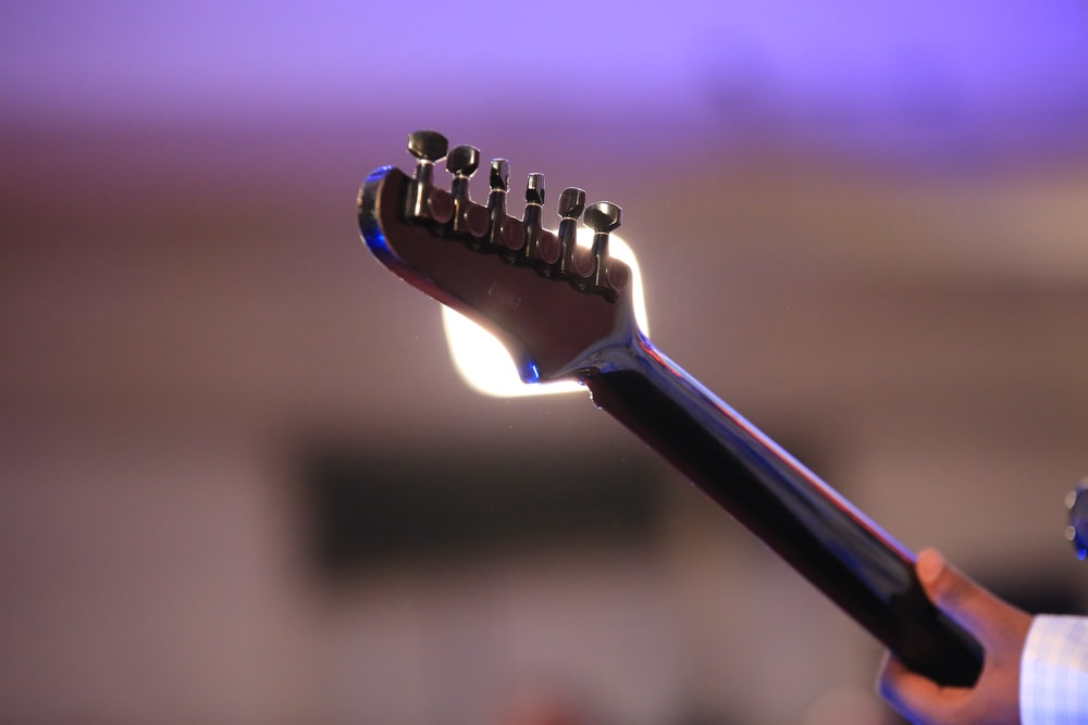 black guitar pick in close up photography