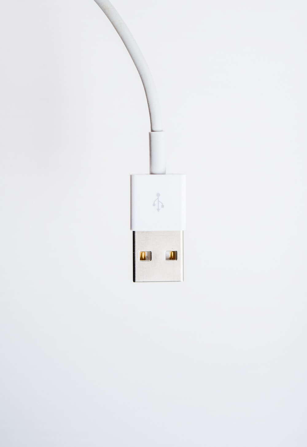white usb cable on white surface