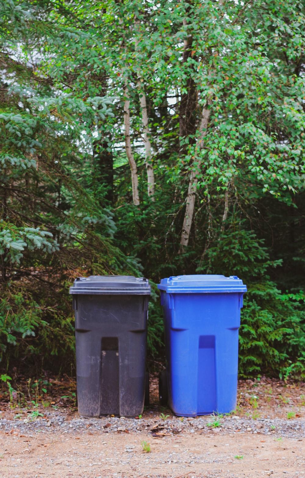 green and blue trash bins