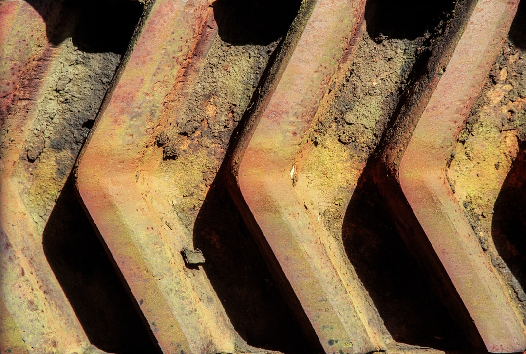 Close up of tractor treads on a farm. The mud almost looks petrified.