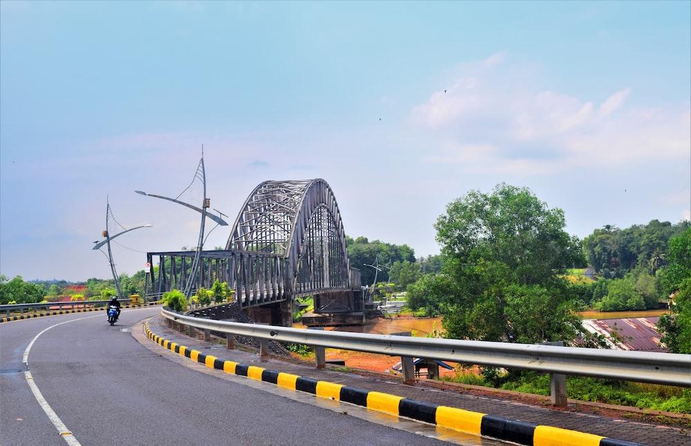 gray concrete bridge under blue sky during daytime