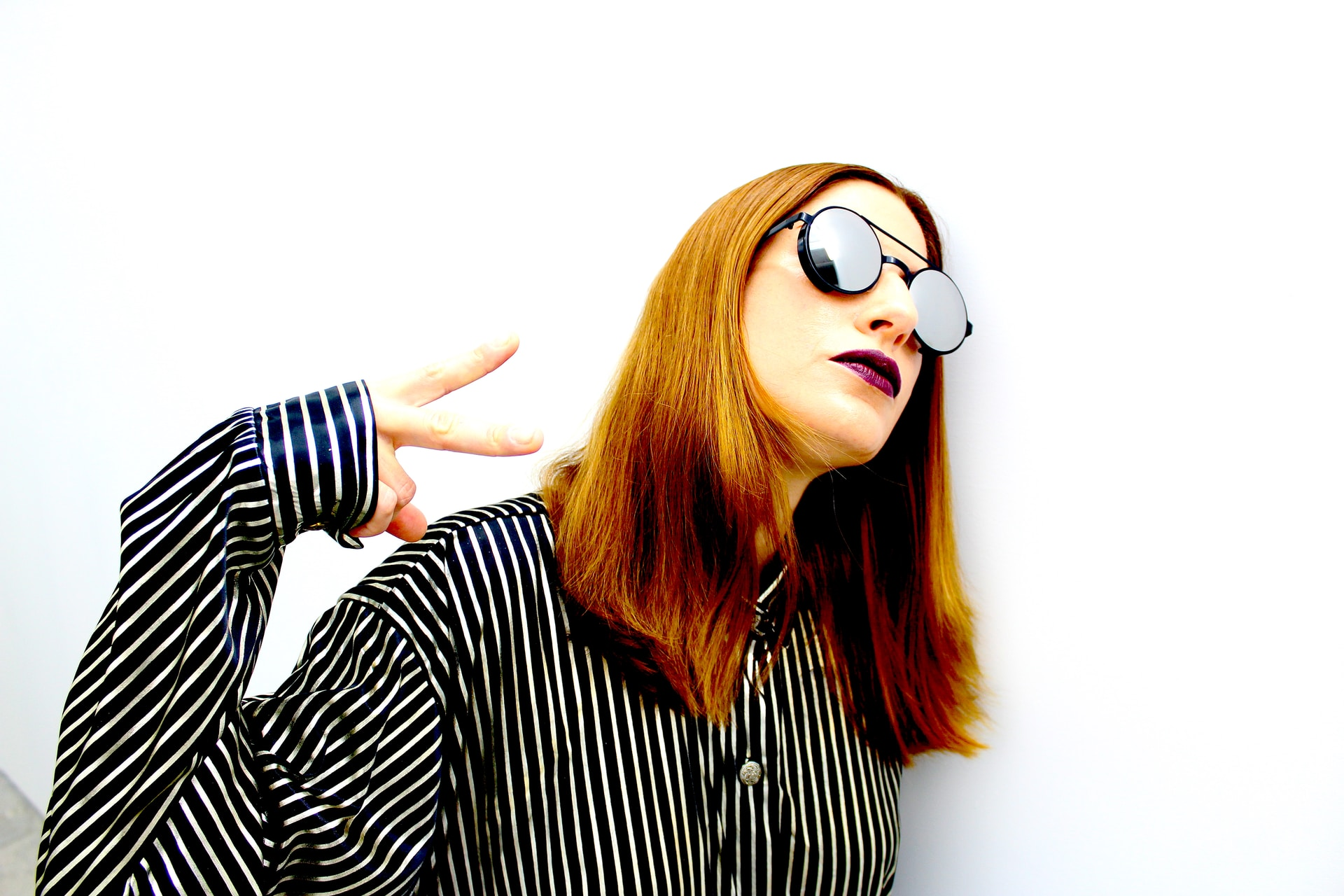 woman in black and white striped long sleeve shirt wearing black sunglasses