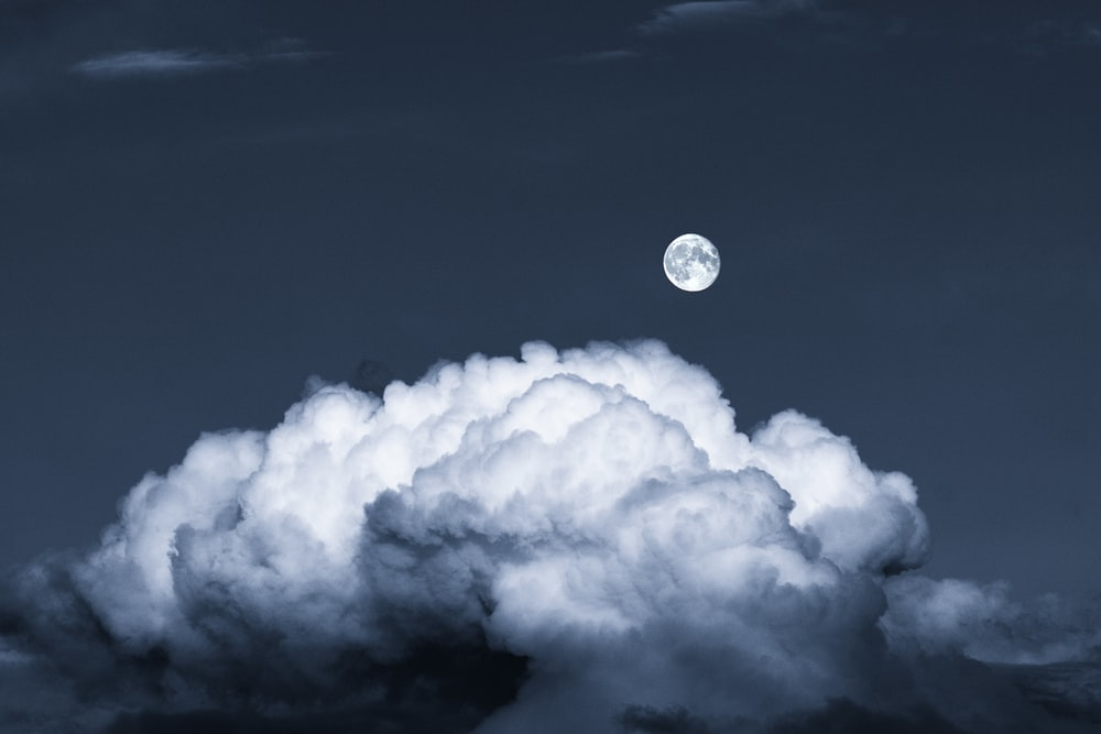 full moon over white clouds