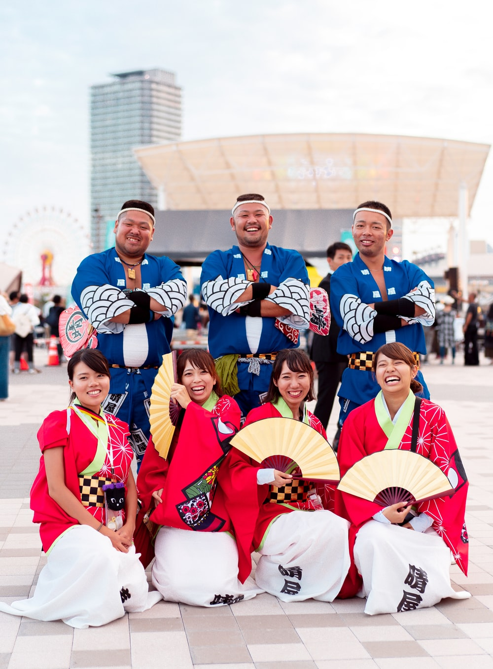 group of people wearing blue and red uniform