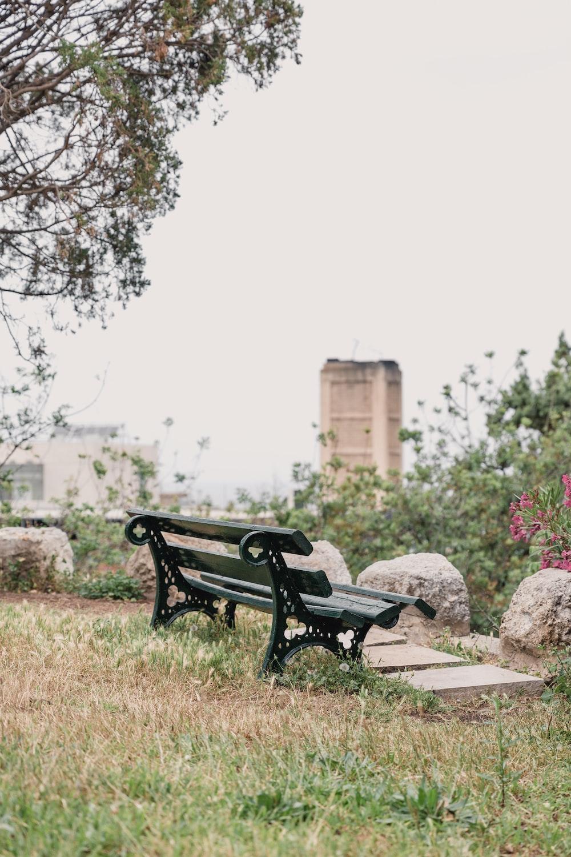 black metal bench on brown dirt ground