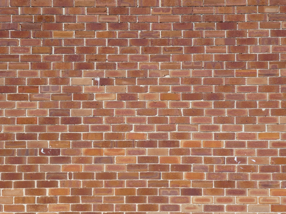 brown and beige brick wall