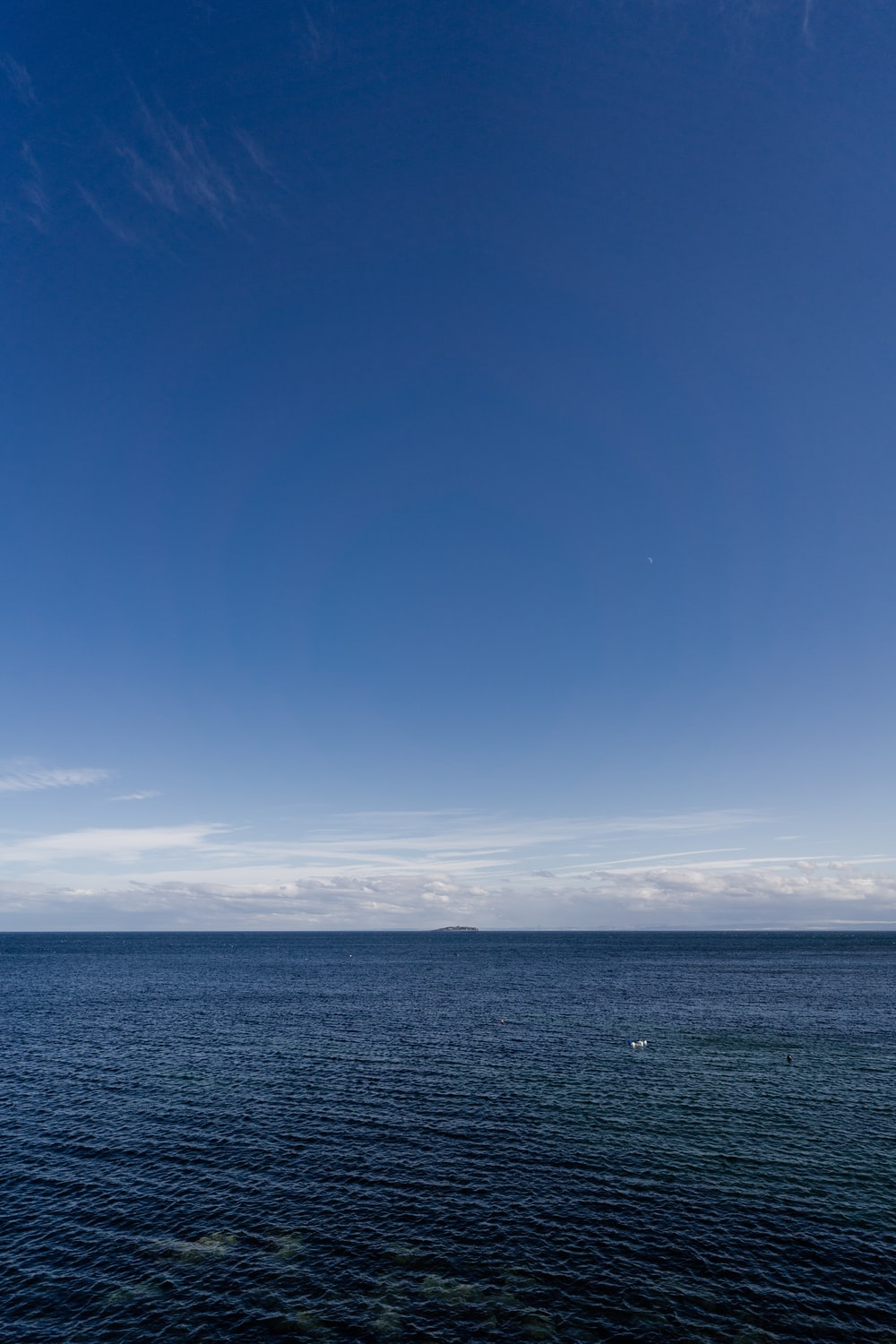 blue sky over sea during daytime
