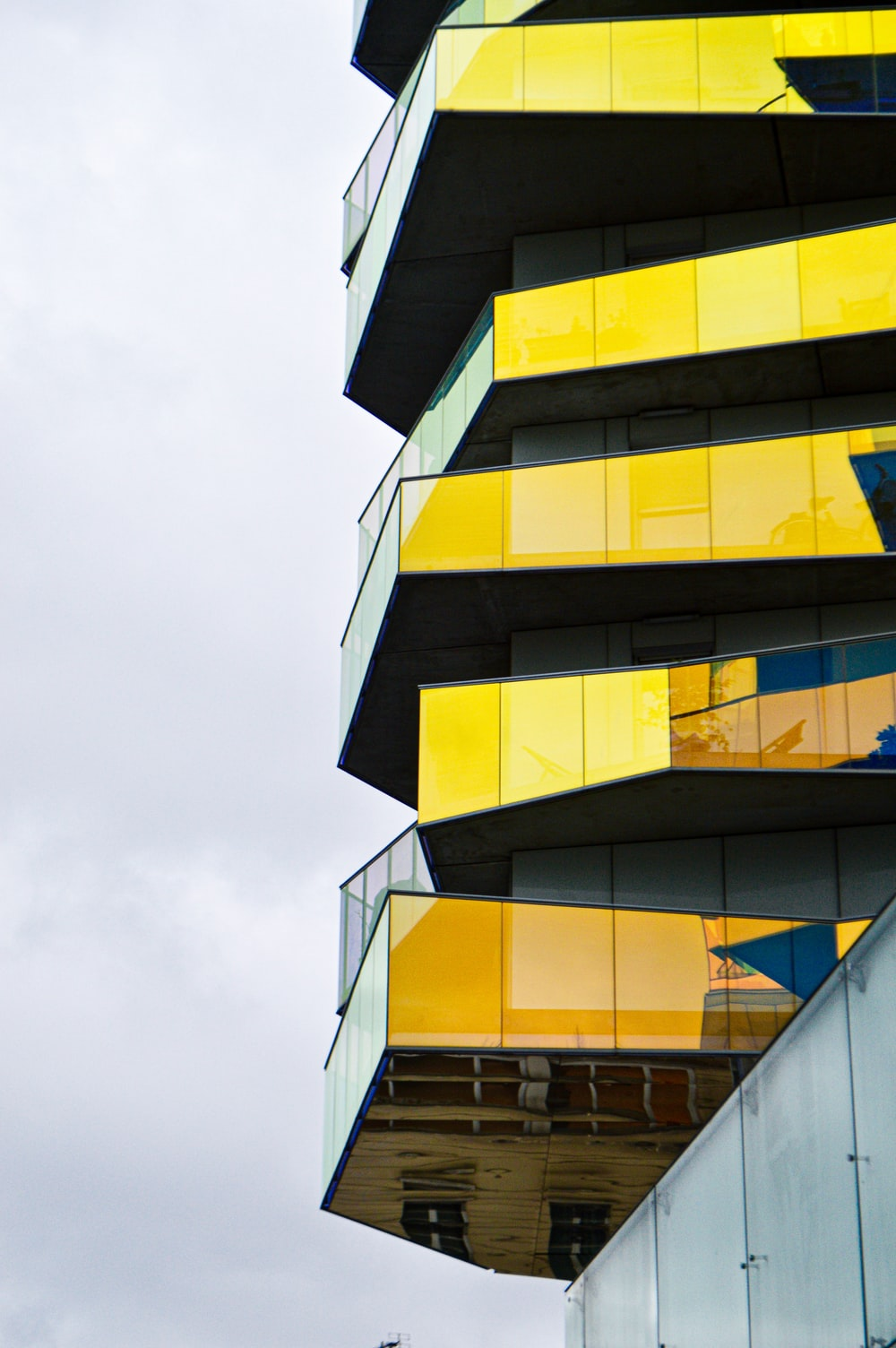 yellow and black building under white sky