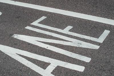 white and black pedestrian line asphalt zoom background