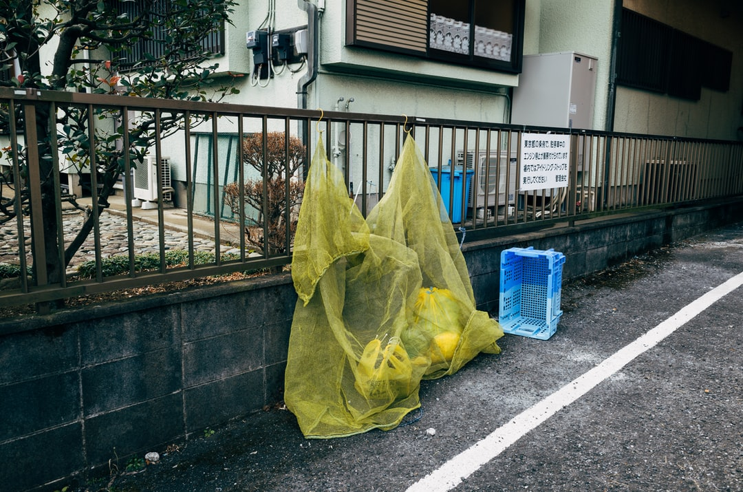 Trash covered in a net in a suburb of Tokyo