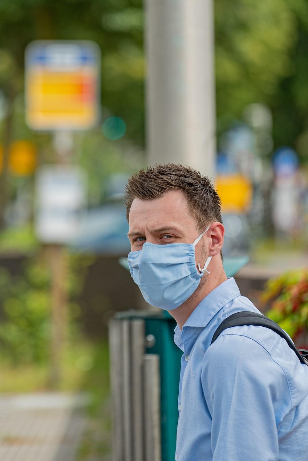 man in blue dress shirt wearing eyeglasses
