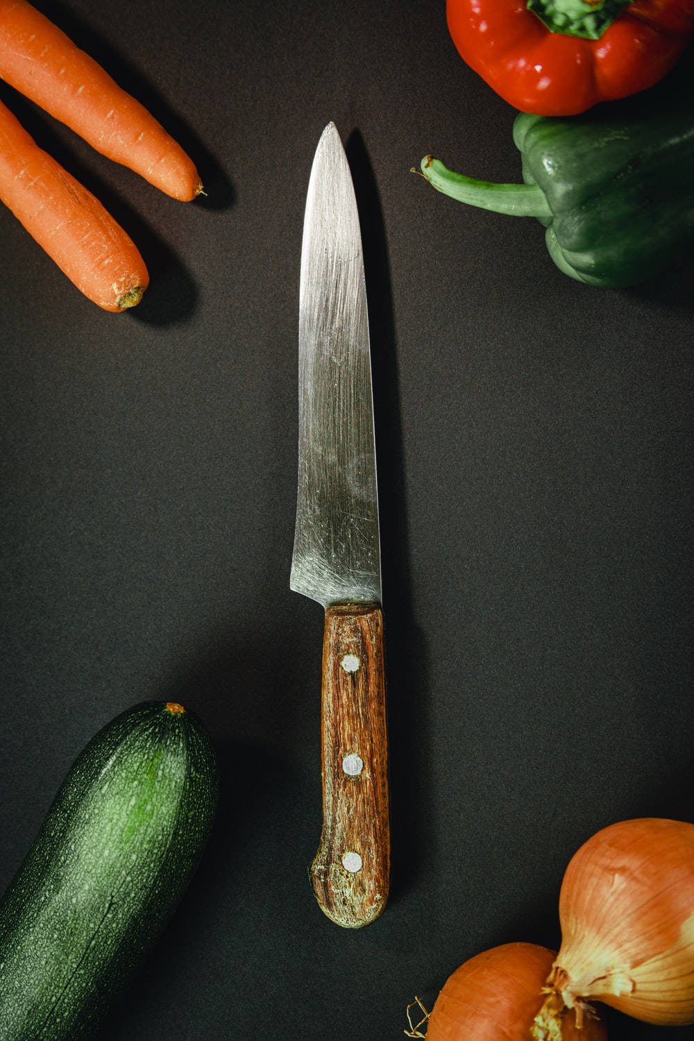 orange and silver kitchen knife