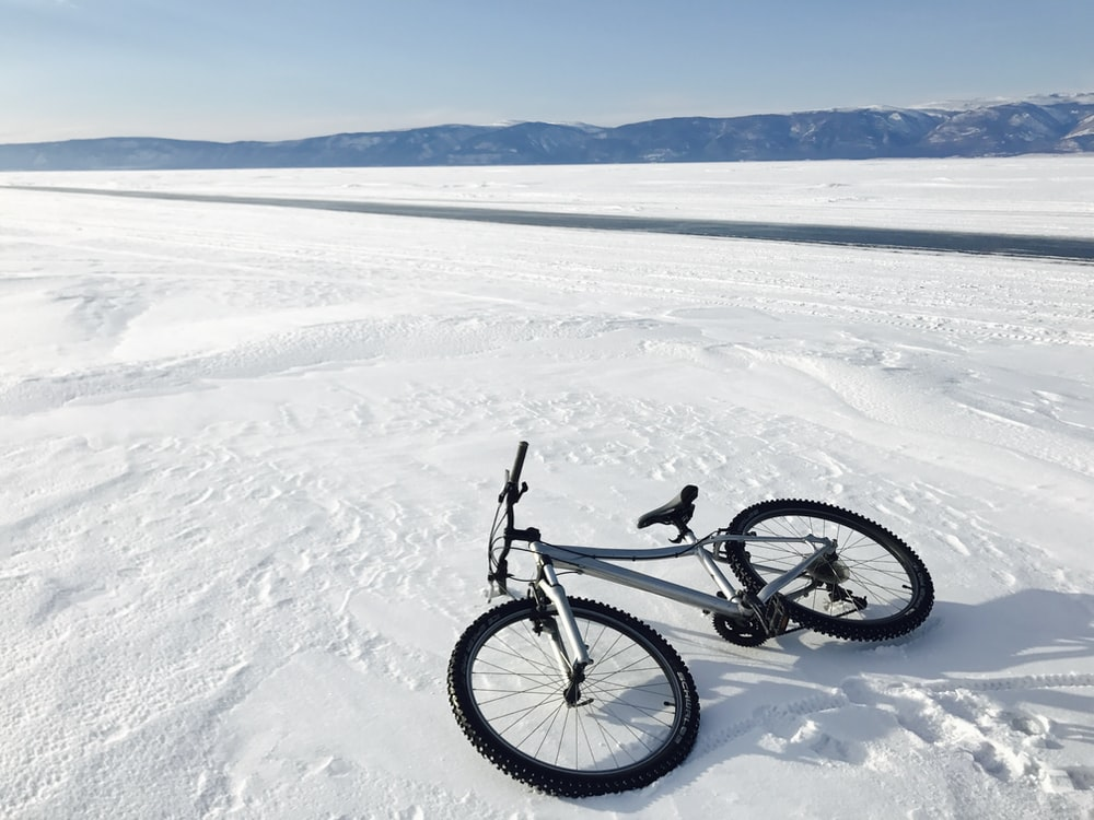 black and gray hardtail mountain bike on snow covered ground during daytime