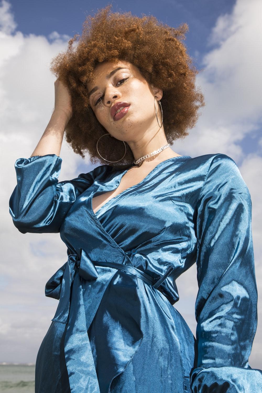 woman in blue long sleeve shirt