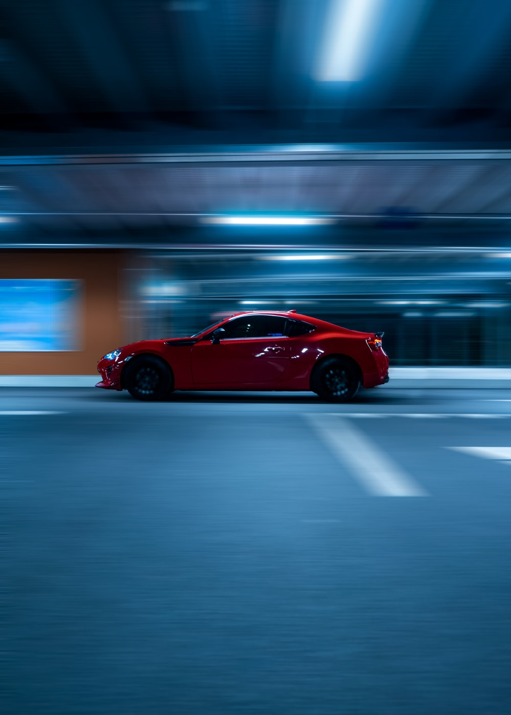 red coupe on road during night time