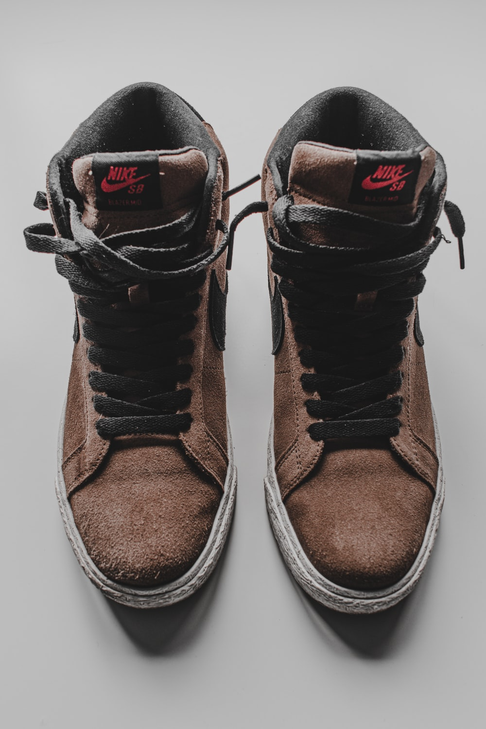 brown and black nike shoes