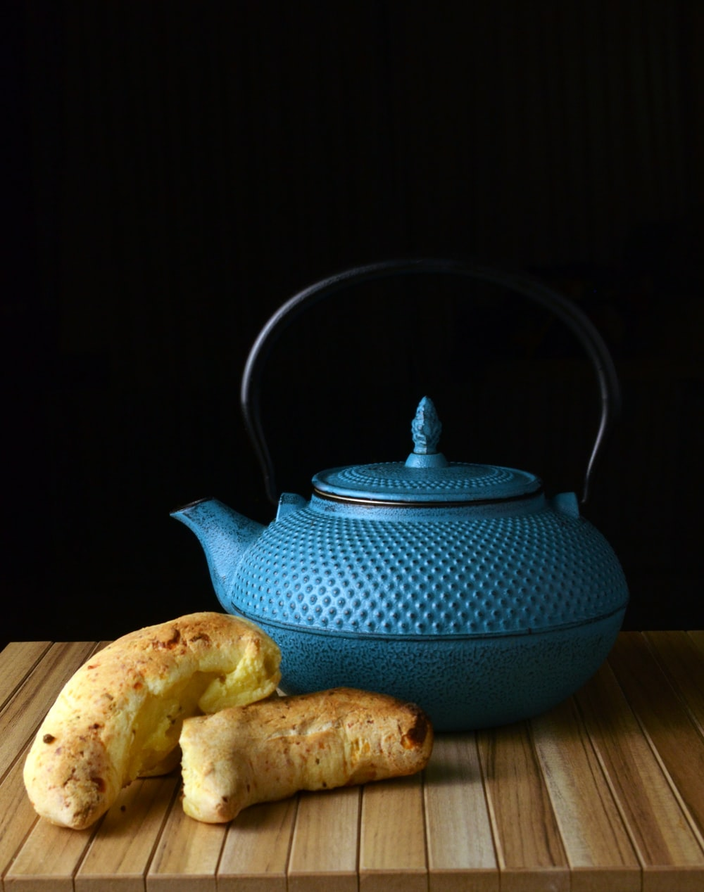 blue ceramic teapot on brown wooden table