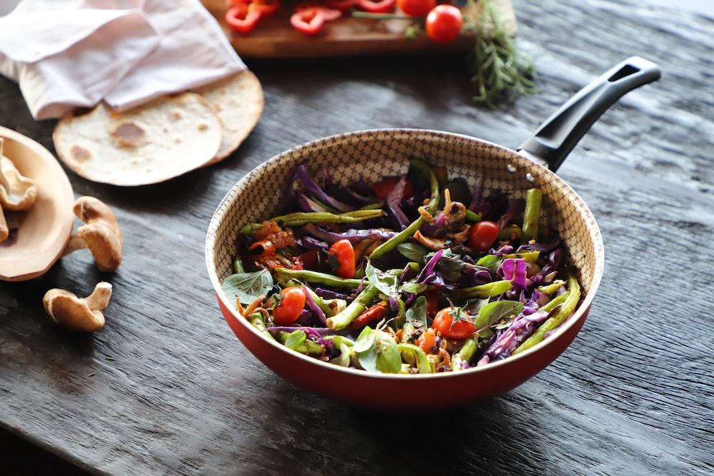 vegetable salad in red ceramic bowl