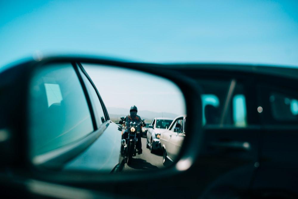 man in black jacket riding motorcycle during daytime