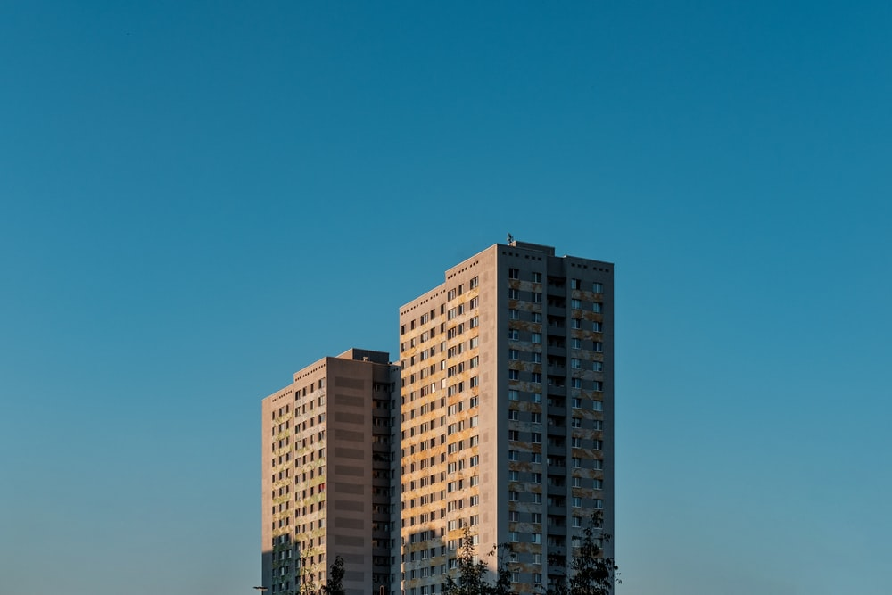 white and brown concrete building under blue sky during daytime