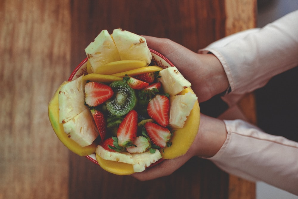person holding sliced fruit with sliced fruit