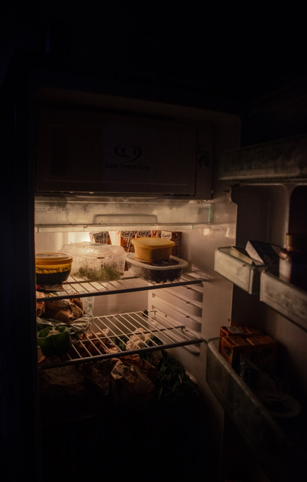 white refrigerator with food inside