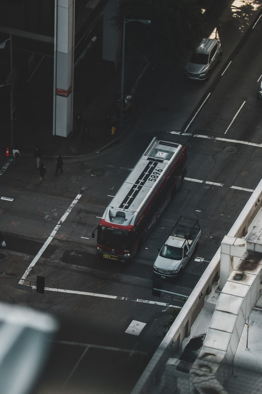red bus on road during daytime