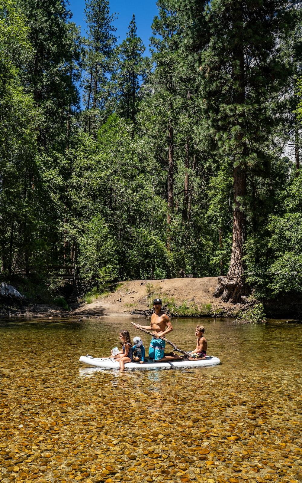 2 women riding on white kayak on river during daytime