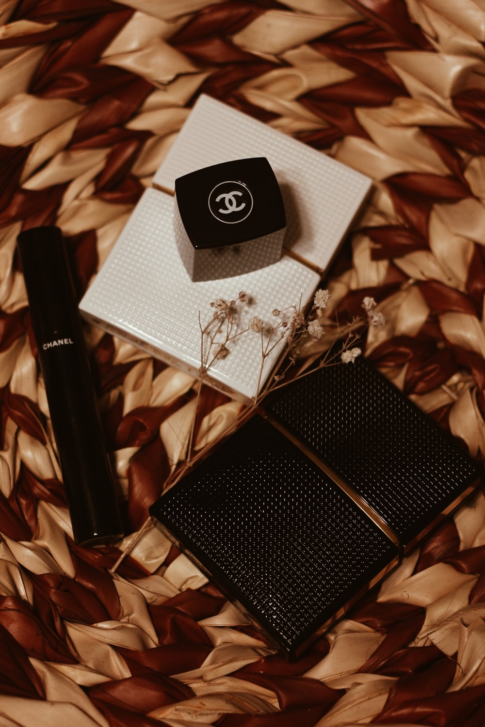 black and white box on white and brown textile