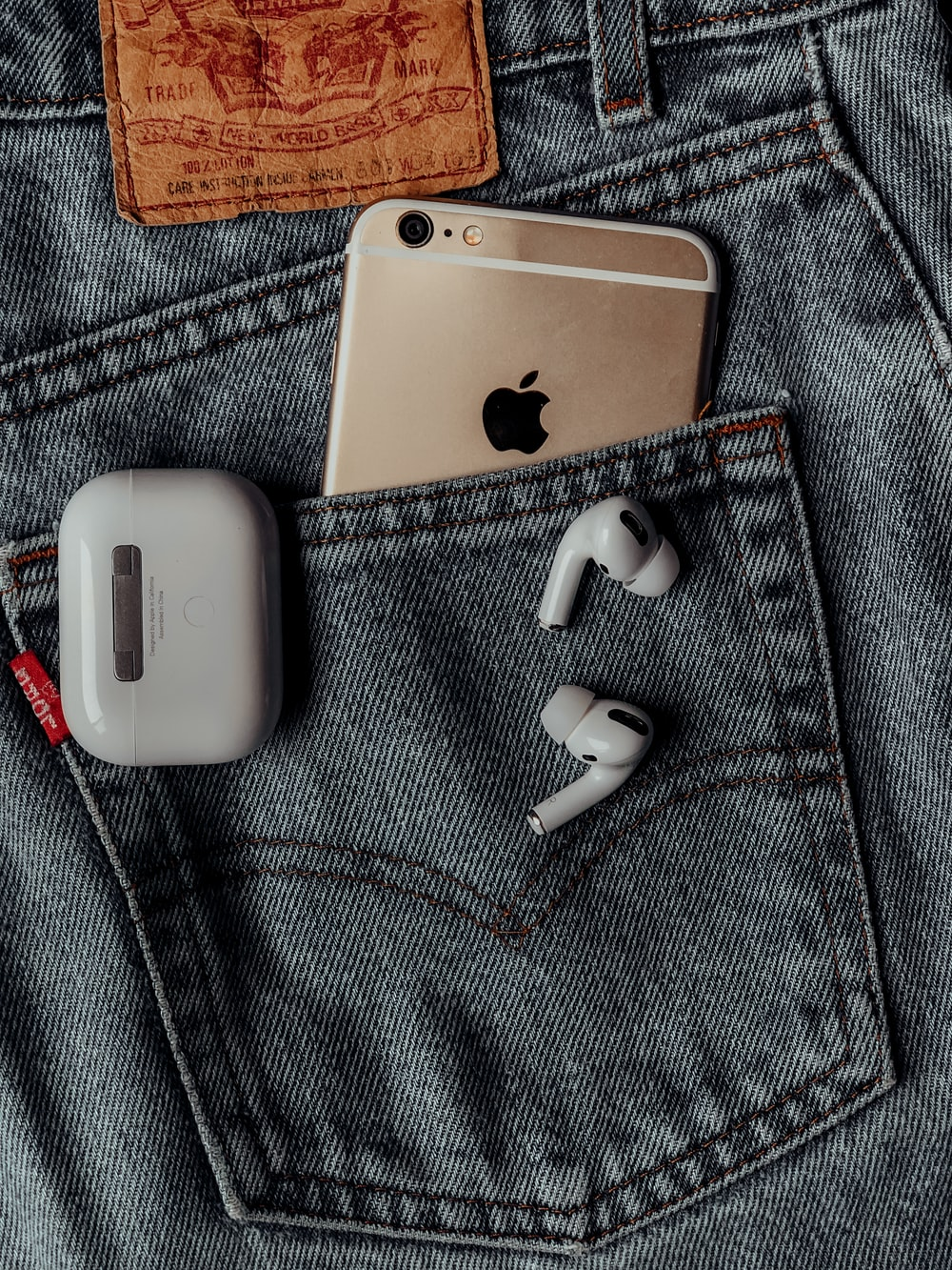 white apple airpods on silver iphone 6