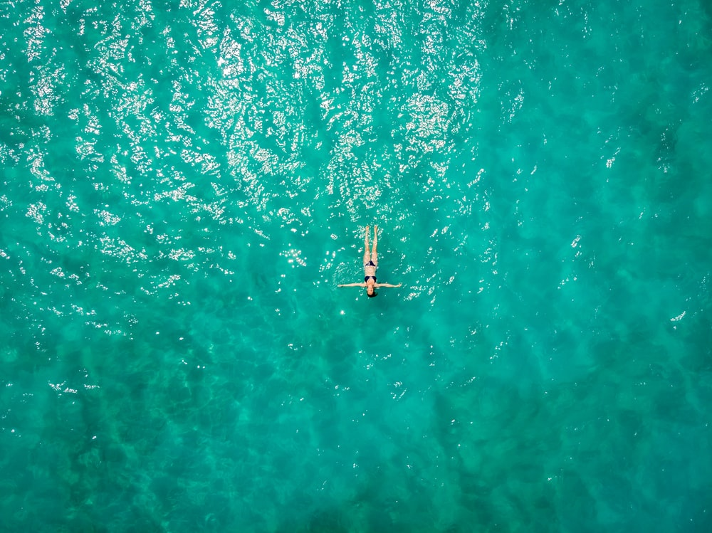 aerial view of person in body of water during daytime