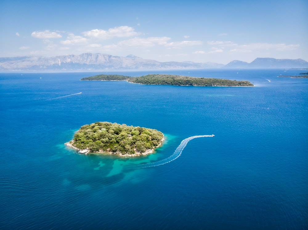 green island in the middle of blue sea
