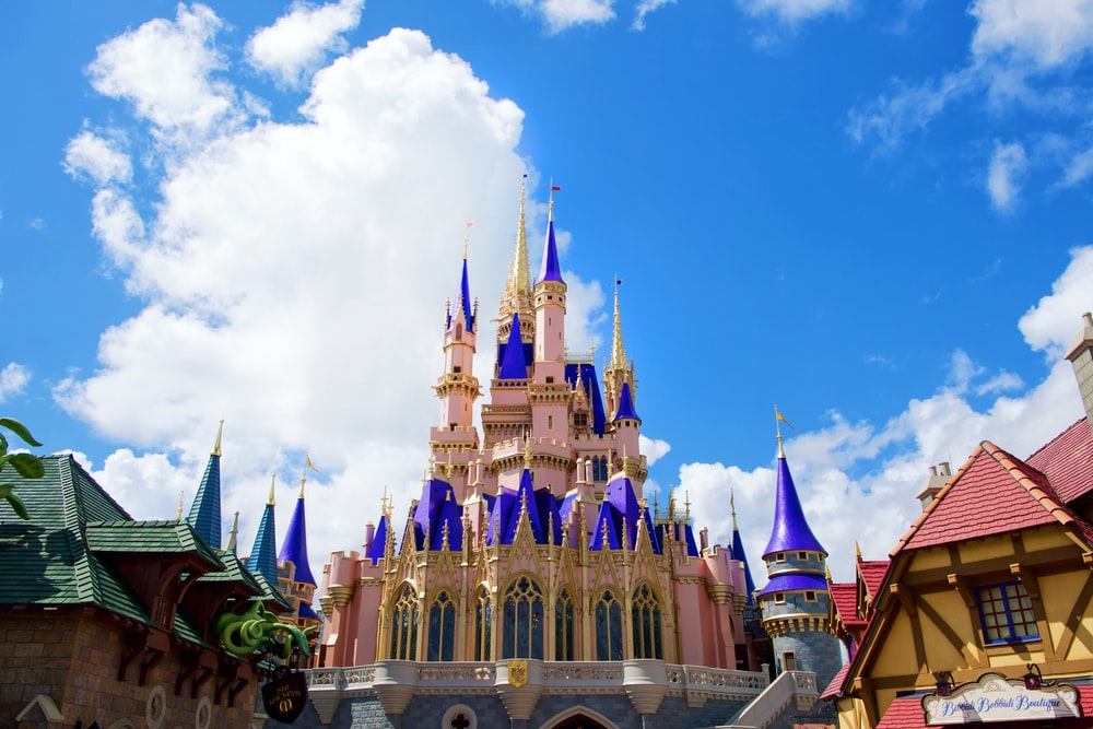 purple and white castle under blue sky