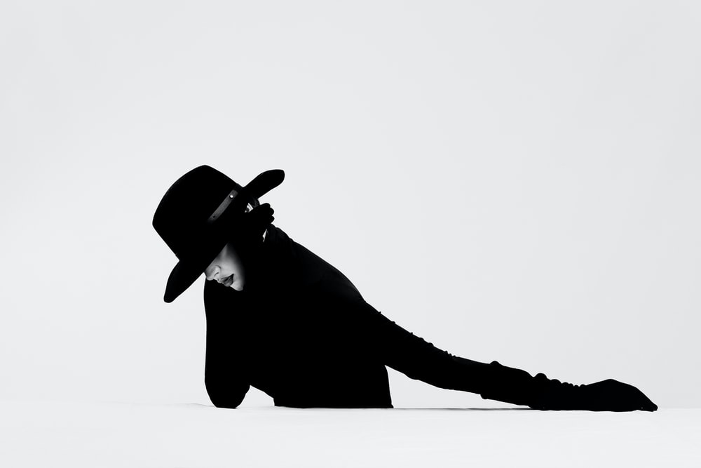 silhouette of a person wearing cowboy hat