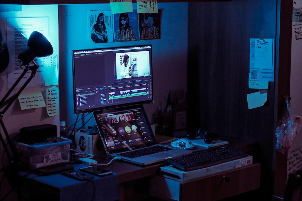 black flat screen computer monitor turned on near black computer keyboard