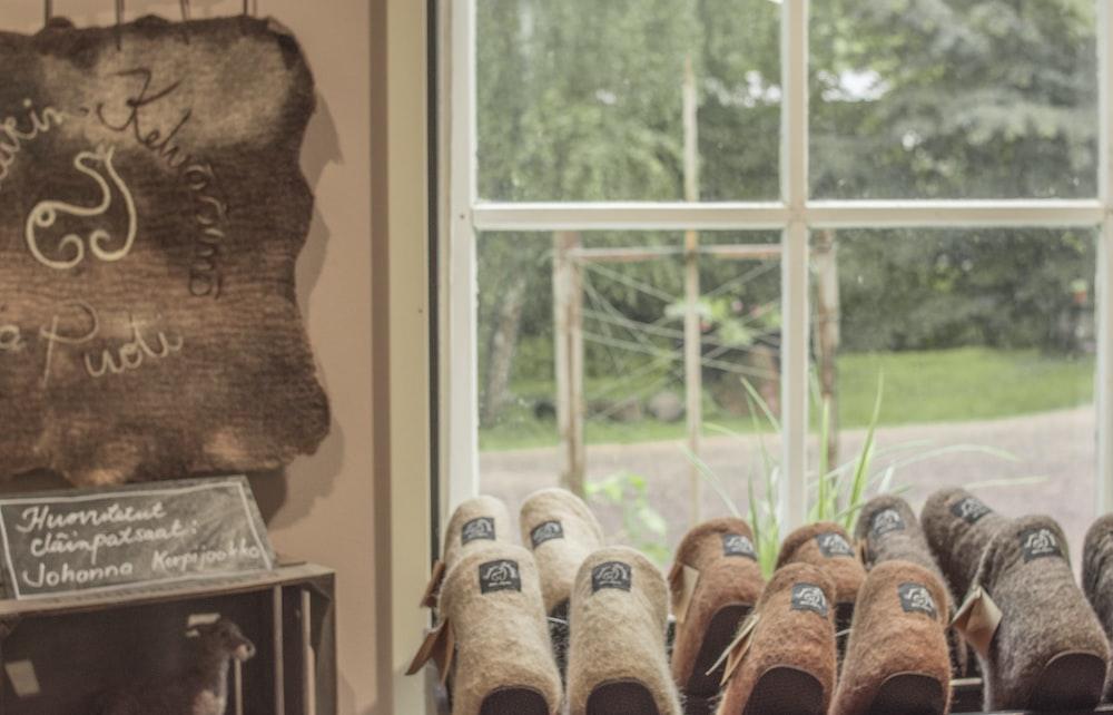 brown wooden hanging decor near window
