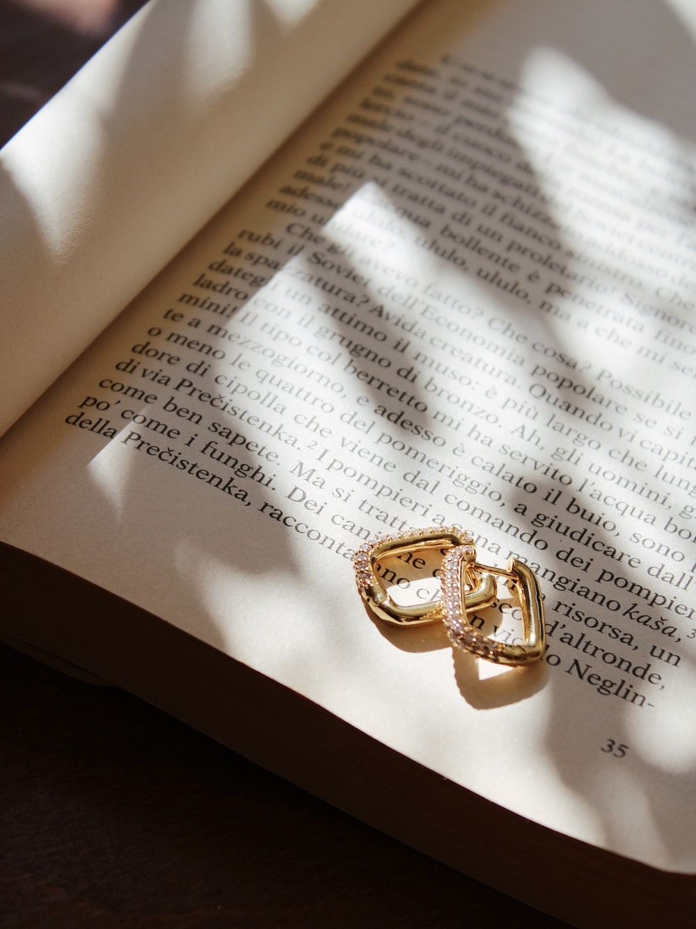 gold ring on white book page