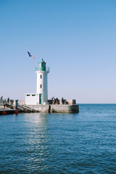 white lighthouse on dock during daytime
