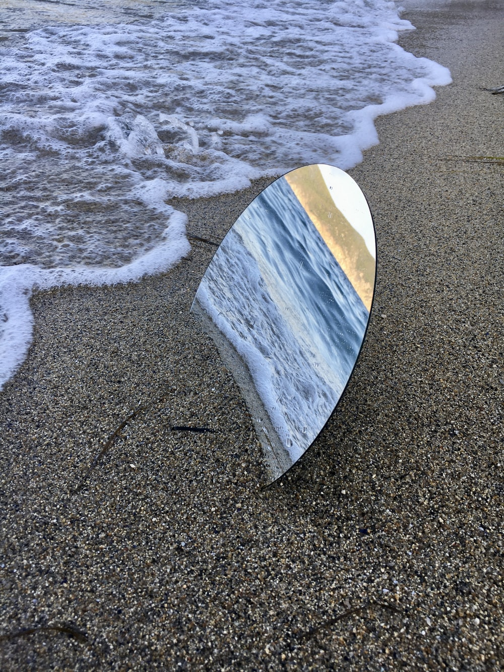 brown and white surfboard on beach shore during daytime