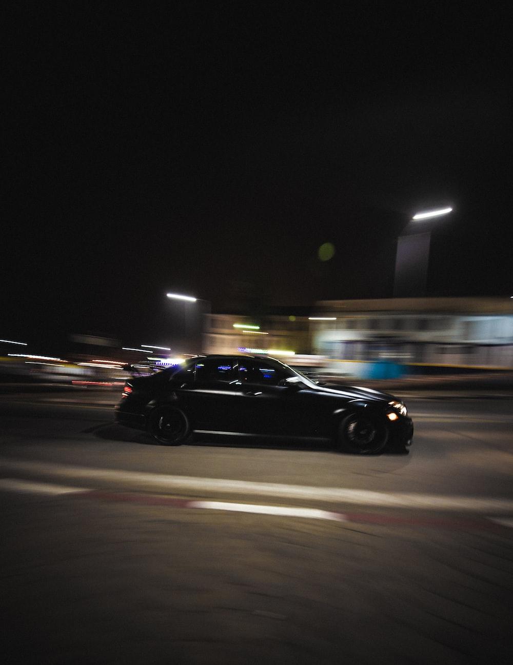 black sedan on road during night time