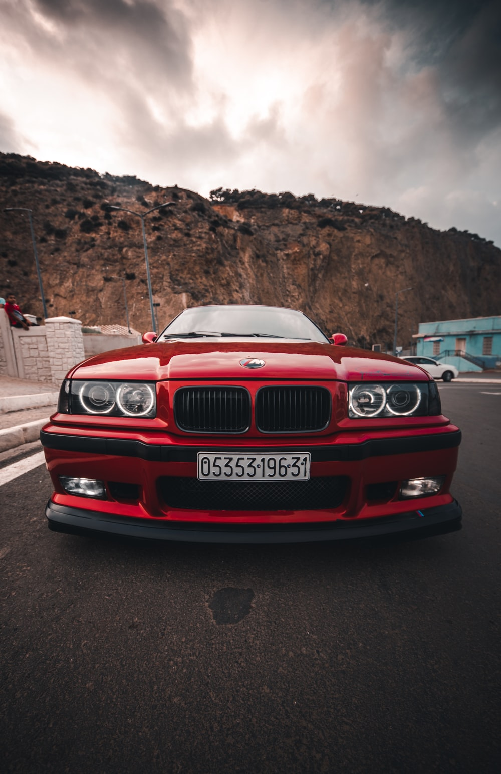 red bmw car on road during daytime