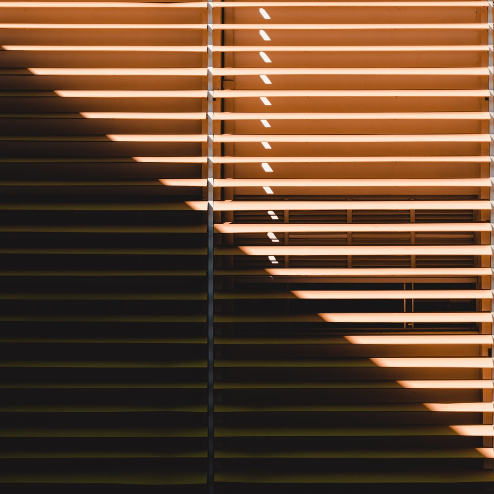 brown window blinds during daytime