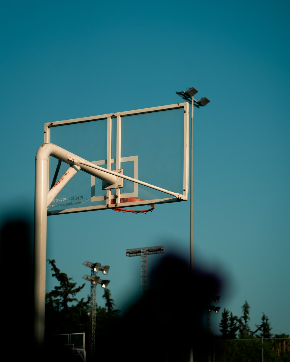 white metal ladder under blue sky