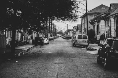 grayscale photo of cars on road new orleans zoom background