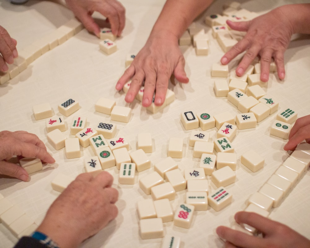 person playing white and brown lego blocks