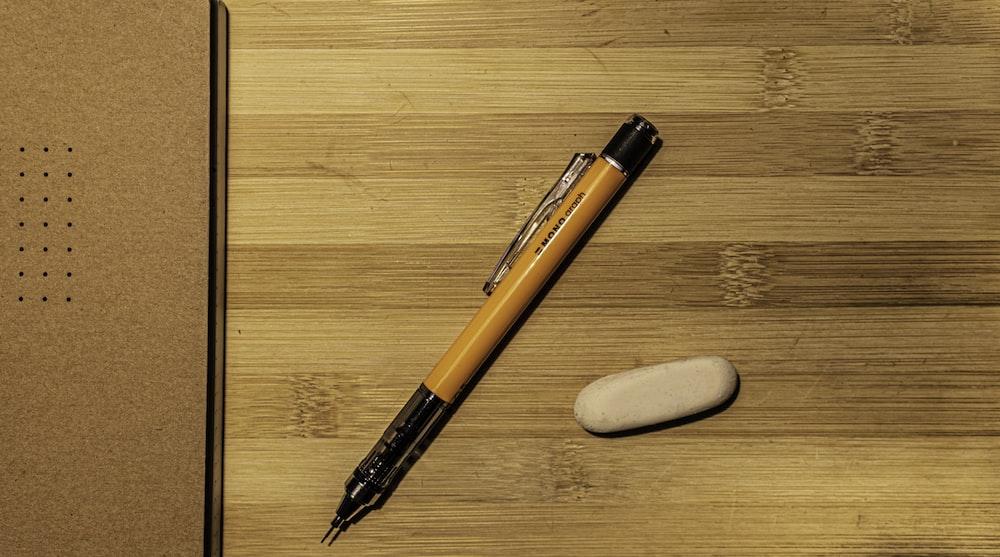 orange and black click pen