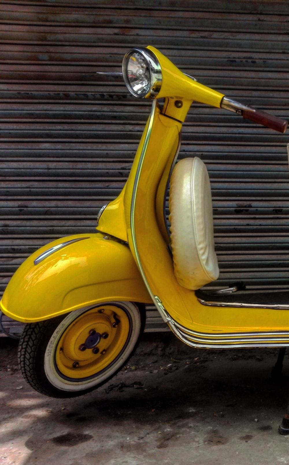 yellow and white motor scooter