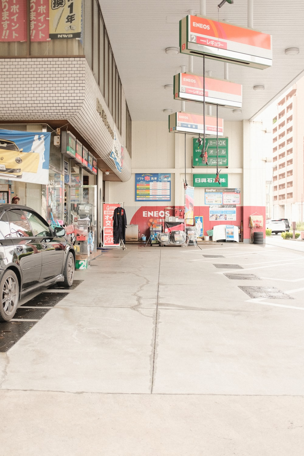 cars parked in front of store during daytime