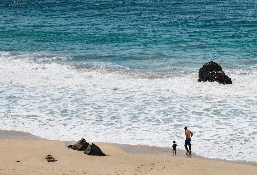 2 Person Standing On Beach During Daytime - unsplash