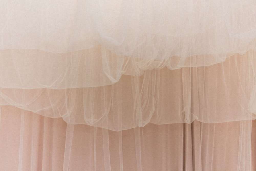 white sheer curtain on window